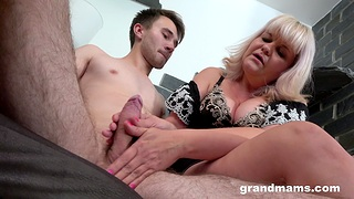 Horny granny gives a blowjob and rides his expansive dick in cowgirl